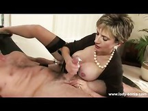 Lady Sonia Hottie wearing pearls and giving a titty wank